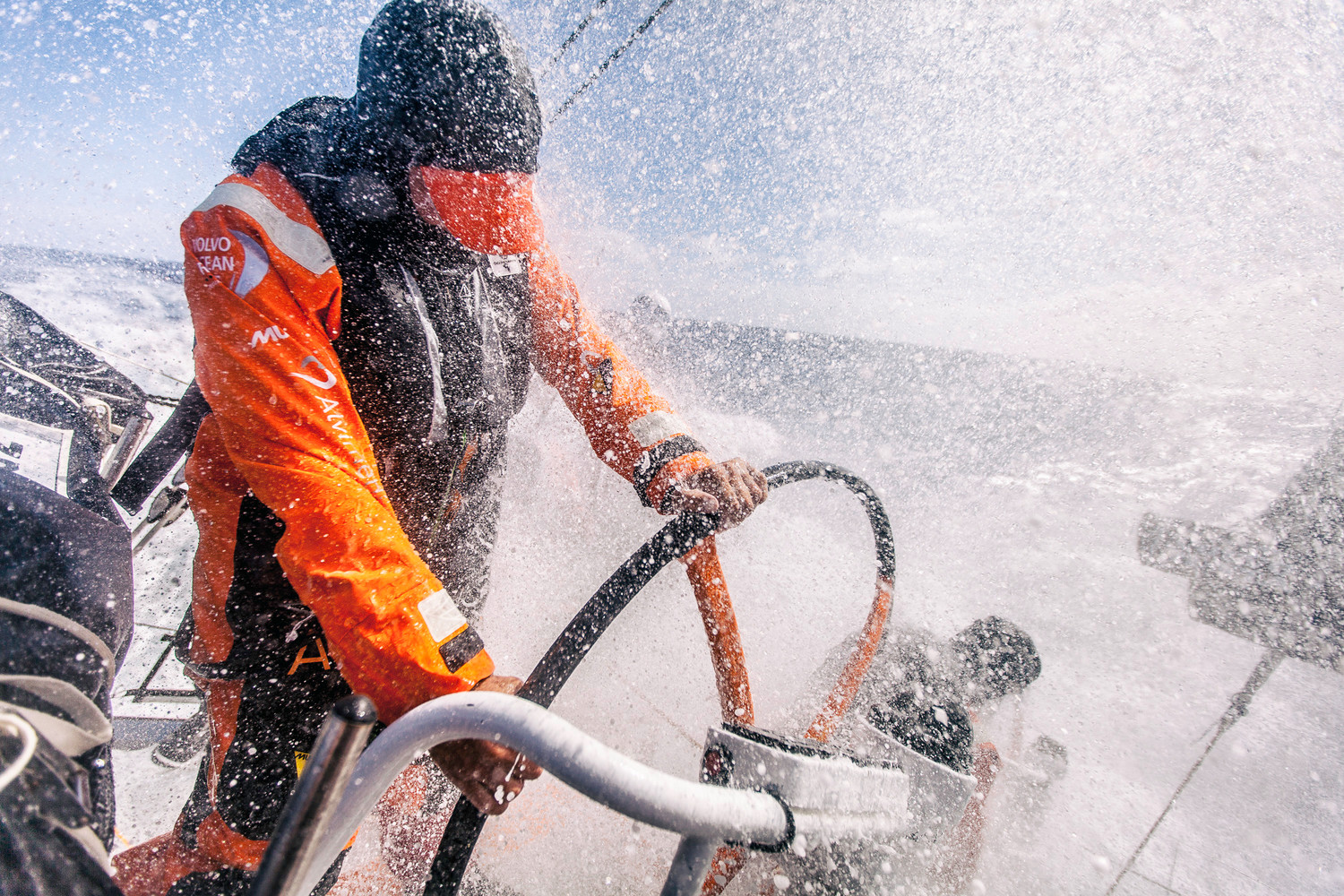 March 19, 2015. Leg 5 to Itajai onboard Team Alvimedica. Day 1. The still weakening Ex-Cylone Pam serves up a dosage of nastiness as the sea state continues to destabilize for the push to get east above it. Ryan Houston lowers his head to keep a wall of water from his eyes. Amory Ross / Team Alvimedica / Volvo Ocean Race