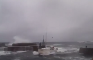 boat trying to reach bornholm harbour in rough seas