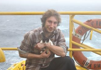 Manu Wattecamps-Etienne with his kitten Pinalup