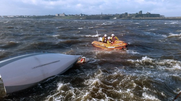 Tynemouth RNLI inshore lifeboat and the capsized dinghy.